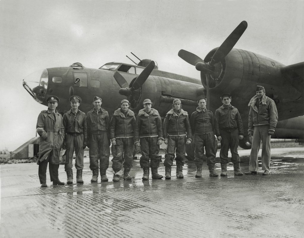 Armstrong (above, far left) took command of the battle-weary 306th Bomb Group in January 1943. After restoring the group to combat readiness, he and this B-17 crew led the first American daytime raid over Germany—a bombing run on the naval base at Wilhelmshaven (below). (IWM FRE 4404)